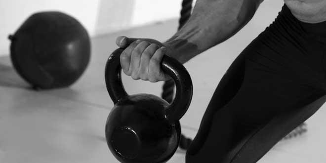Curl de Bíceps con Pesa Rusa