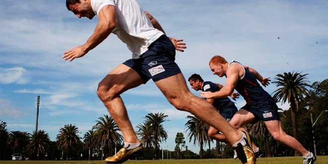 Three men running