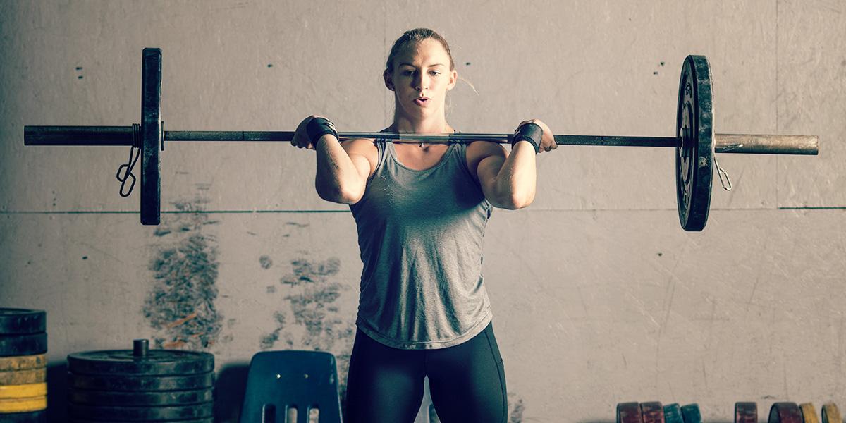 Fitness girl lifting
