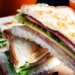 Turkey, lettuce and tomato wholemeal bread sandwich and orange juice