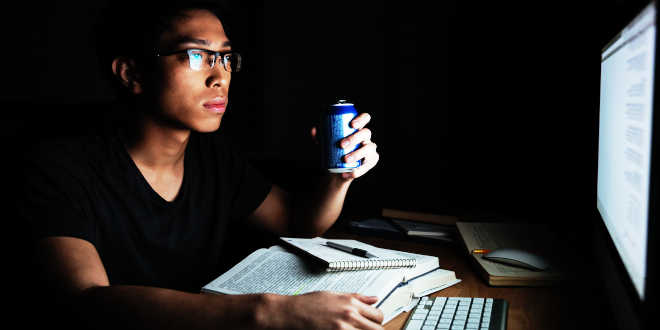 A student drinking an energy drink