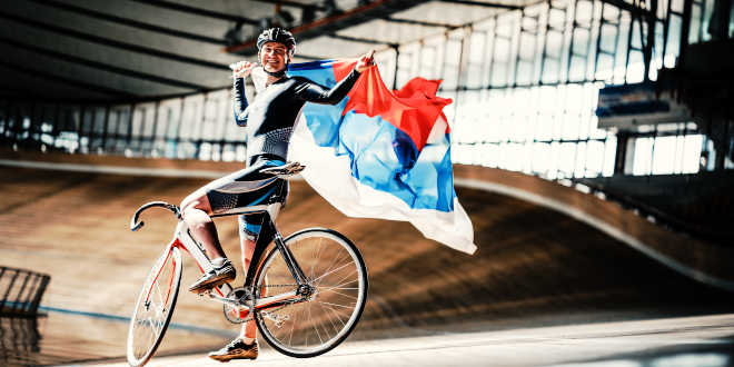 Cyclist holding a flag