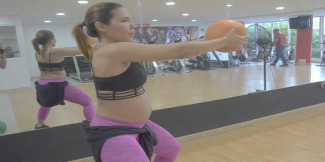 Pregnant woman doing physical exercise