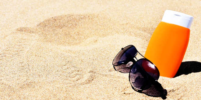 Sunscreen and Sunglasses at the beach