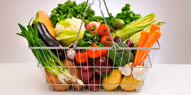 A basket with fresh vegetables and fruit
