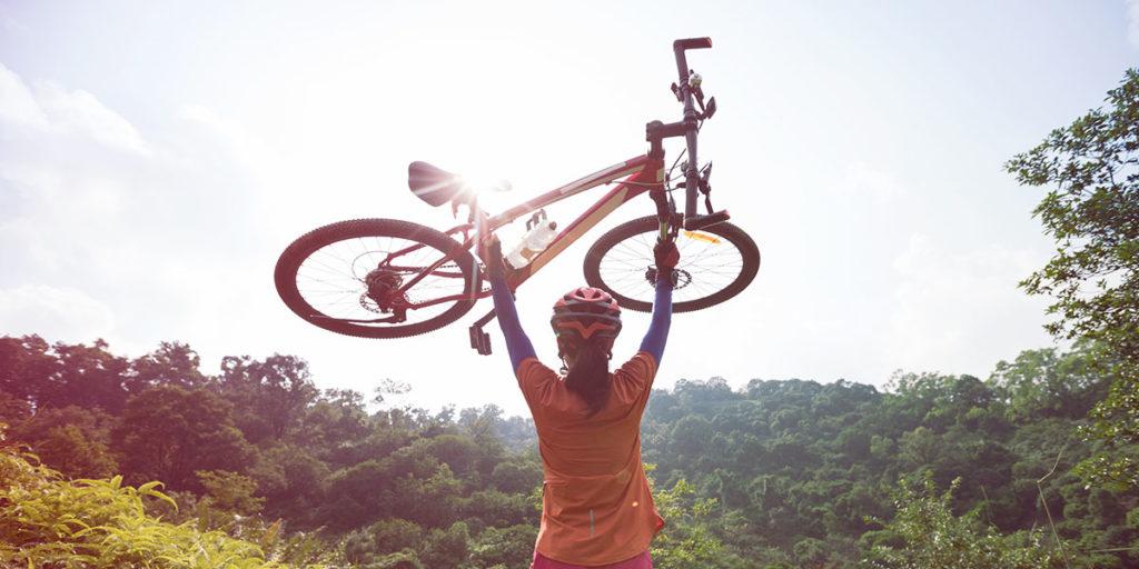 Girl holding a bike