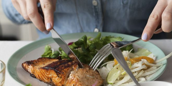 A dish of salmon, salad