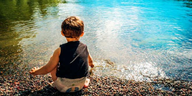 Child on a lake