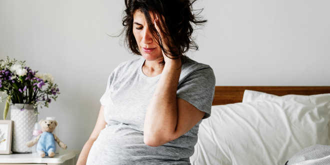 Pregnant woman looking tired