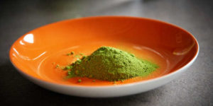 Moringa powder in a bowl