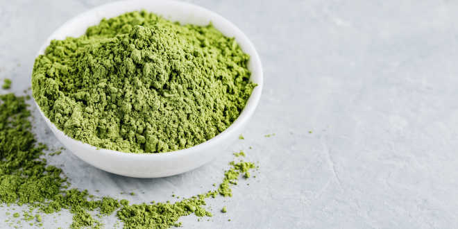 A bowl of matcha tea powder