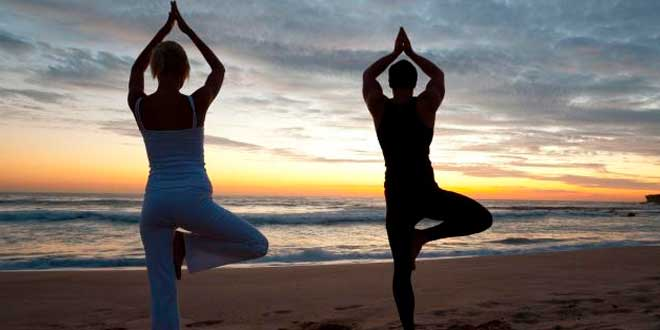 Couple doing yoga poses