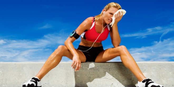 Adult woman sitting on a ledge