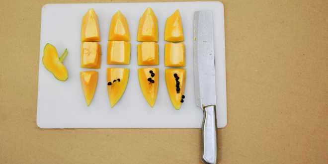 Cleaning papaya with a knife