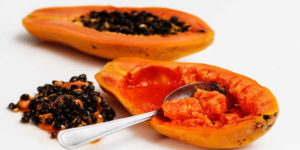 Papaya cut in half with a spoon