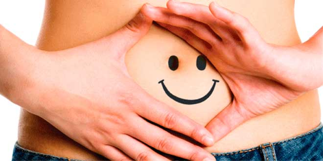 Happy face drawn on a belly