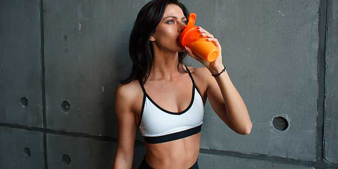 A woman drinking a protein shake
