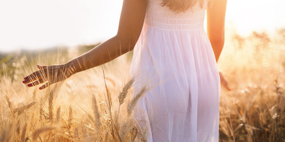 Woman on a barley grass field