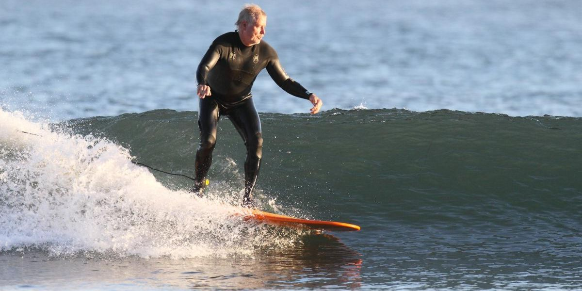Old man surfing