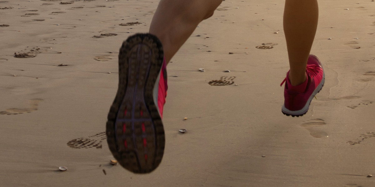 Running on the beach with or without trainers?